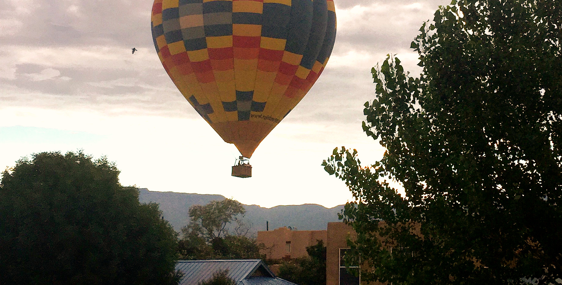 Balloon flying by the house