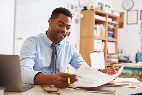 African American male teacher working at