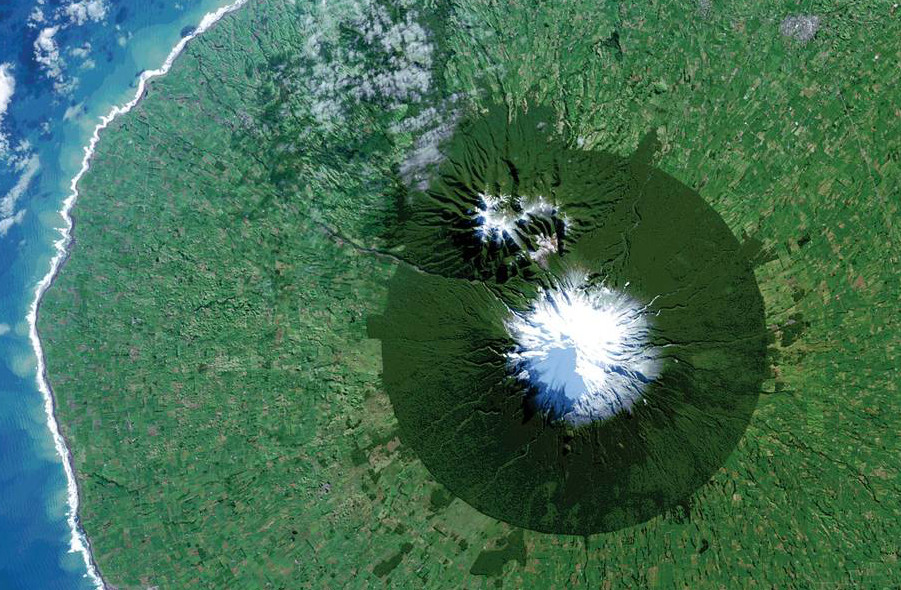The almost perfectly shaped circle clearly shows the borders of Egmont National Park surrounding Mount Taranaki ((c) NASA / USGS)