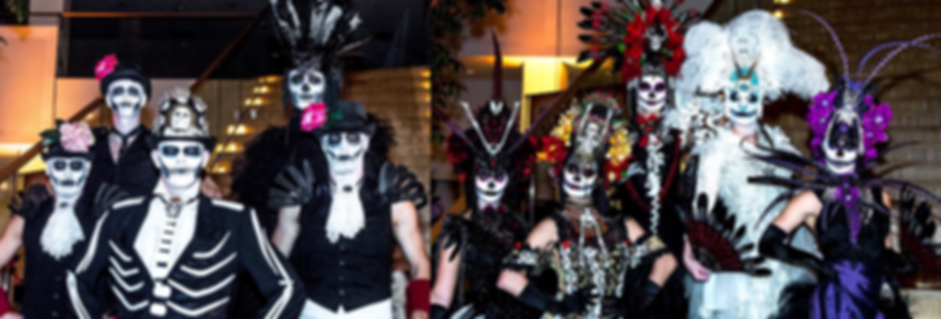 Artists are posing in their Day of the Dead Costumes