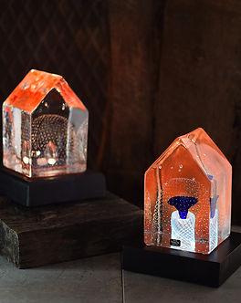 Limiterat konstglas belyst glaskonst