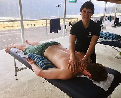 Karla massaging at rowing.jpg