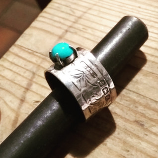 turquoise silve ring in claw settign on silver band