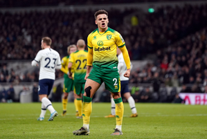 Max Aarons playing for Norwich City in a Premier League game against Tottenham Hotspur