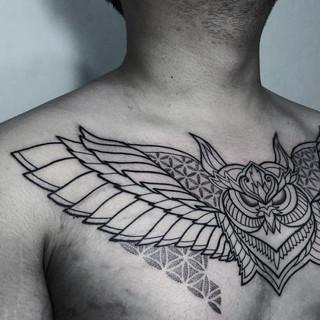 Line work chest tattoo.jpg