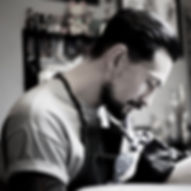 Arthur Kim traditional tattoo artist at charlie rose tattoo in canggu bali specializing in traditional colour tattoos