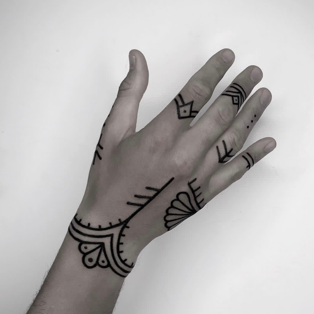 line work hand tattoo