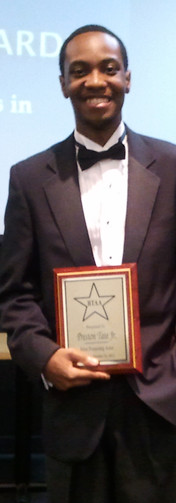 Receiving the Denzel Washington Award for Most Promising Actor at the Black Theatre Alliance Awards