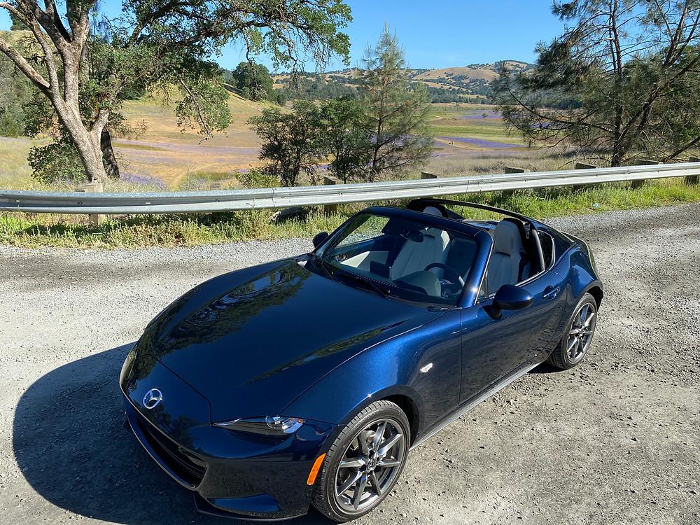 2021 Mazda Miata MX-5 Miata RF Grand Touring front 3/4 view roof down