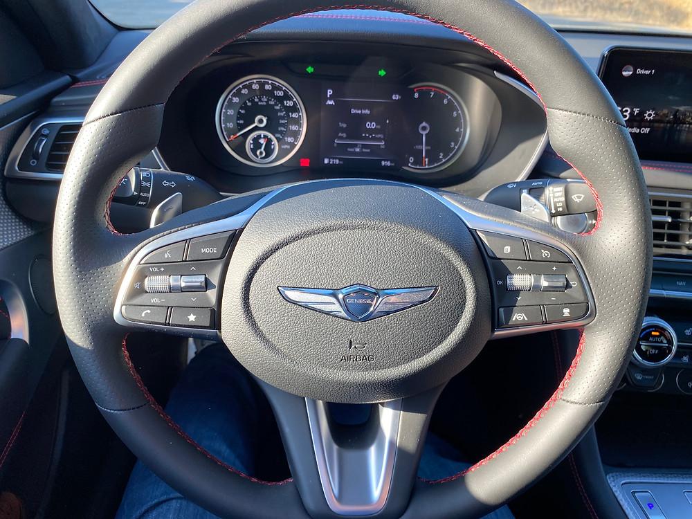 2022 Genesis G70 RWD 3.3T Sport Prestige steering wheel and gauge cluster