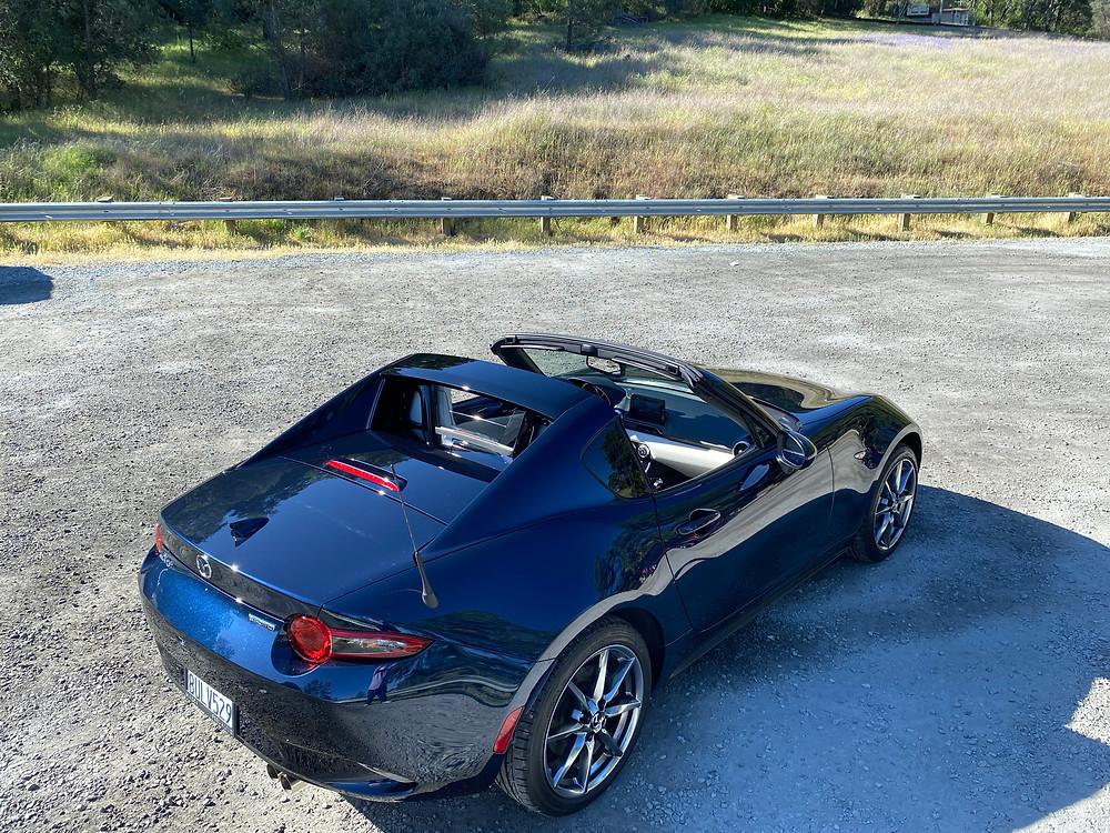 2021 Mazda MX-5 Miata RF Grand Touring rear 3/4 view roof down