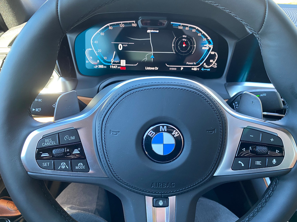 2021 BMW 330e steering wheel and gauge cluster