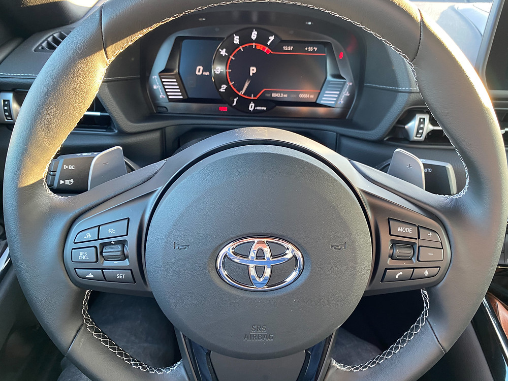 2021 Toyota GR Supra gauge cluster through steering wheel