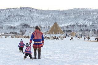 Sami family walking to reindeer camp