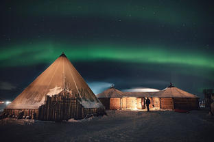 Reindeer camp under the northern lights