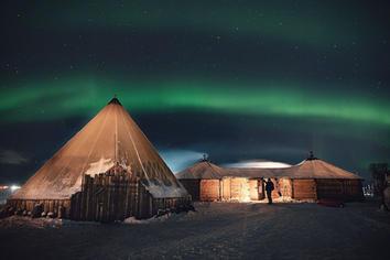 Reindeer camp under the northern lights