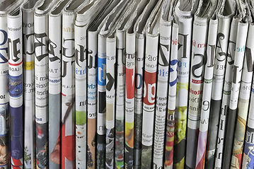 Folded%20Newspapers_edited.jpg