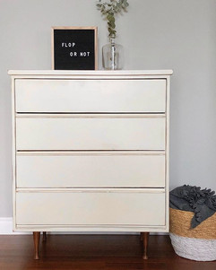 This tall dresser is missing her partner