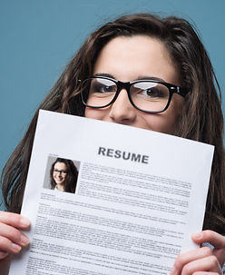 Young woman hiding behind her resume.jpg