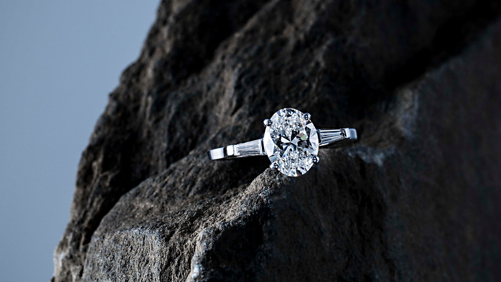 Custom design oval & tapered baguette trilogy engagement ring