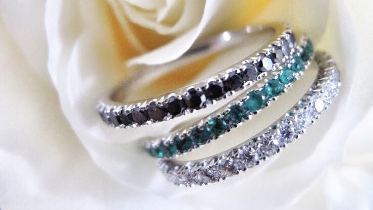 Black & white diamond and green emerald eternity bands