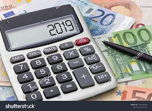 stock-photo-calculator-with-euro-bills-1