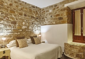 bedroom-with-stone-walls-comfortable-mod