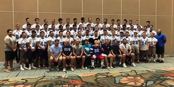 Team photo with Mickey at Disneyworld, FL