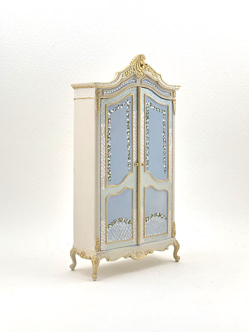 Hand painted wardrobe in soft blue tones