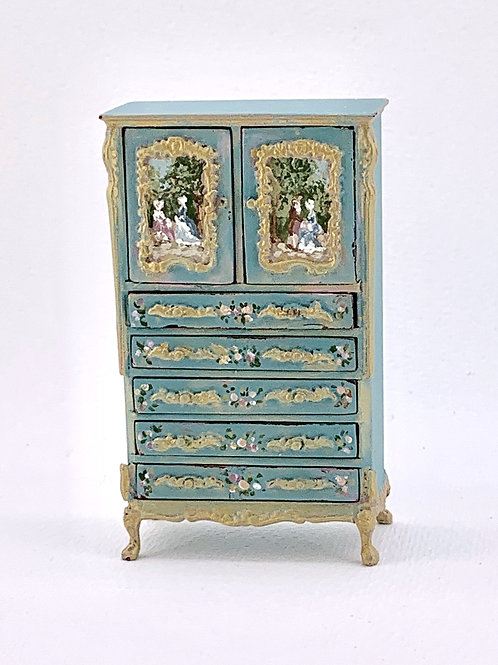 Hand-painted furniture in turquoise tones with French motifs.