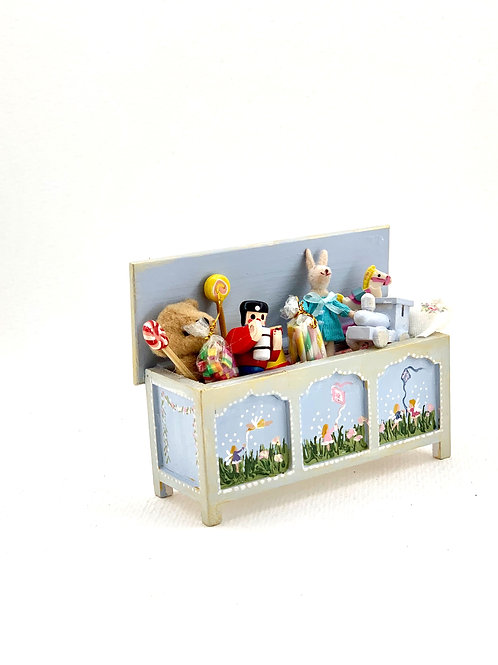 hand-painted toy trunk in soft blue tones