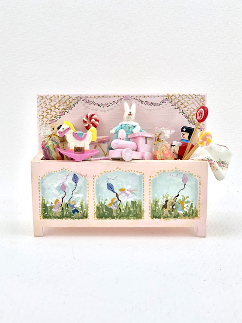 Hand-painted toy trunk in soft pink tones