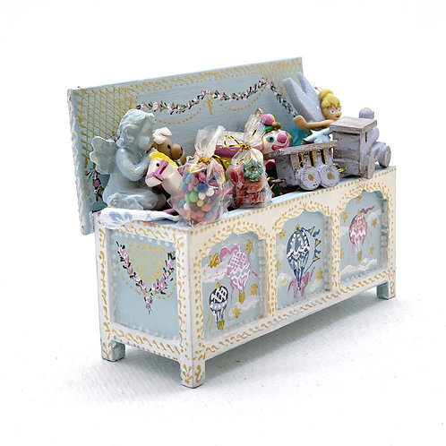 Hand painted toy trunk in baby blue tones.