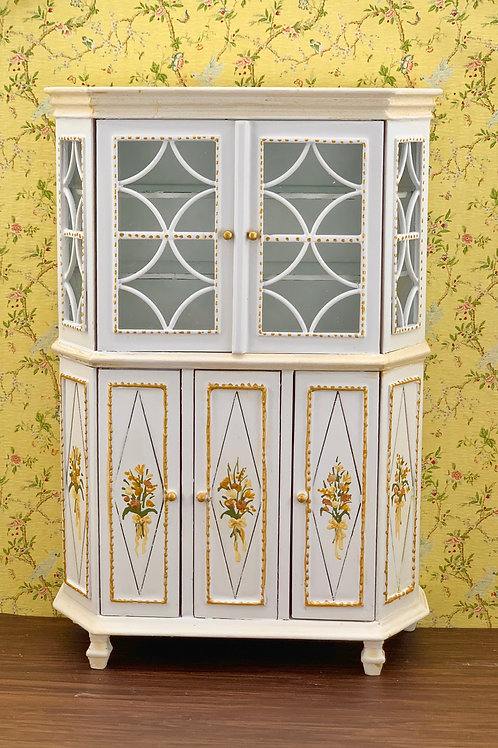 showcase with glass doors and shelves with details of hand-painted flowers in so