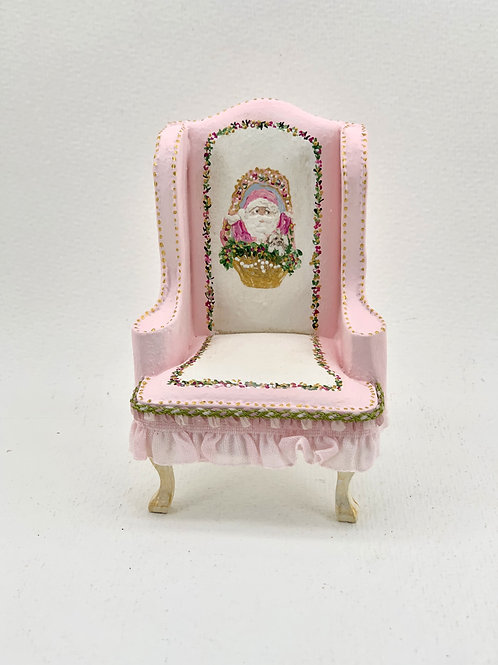 hand painted pink wingchair sofa with Christmas motifs