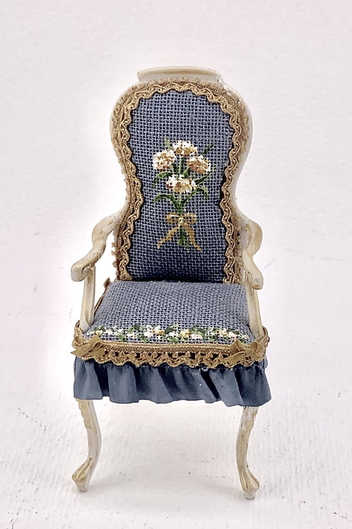 Chair with arms upholstered in blue linen and hand painted, silk trimmings. scal