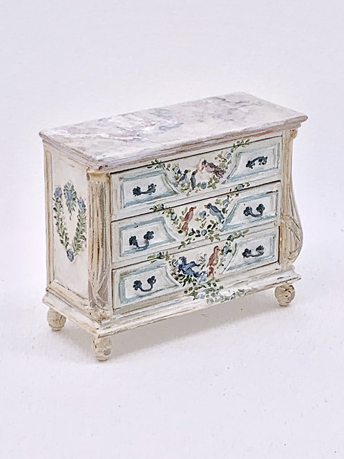 Chest of drawers with hand-painted drawers in blue and white tones with imitatio