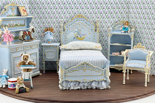 hand-painted child's bed in soft blue tones