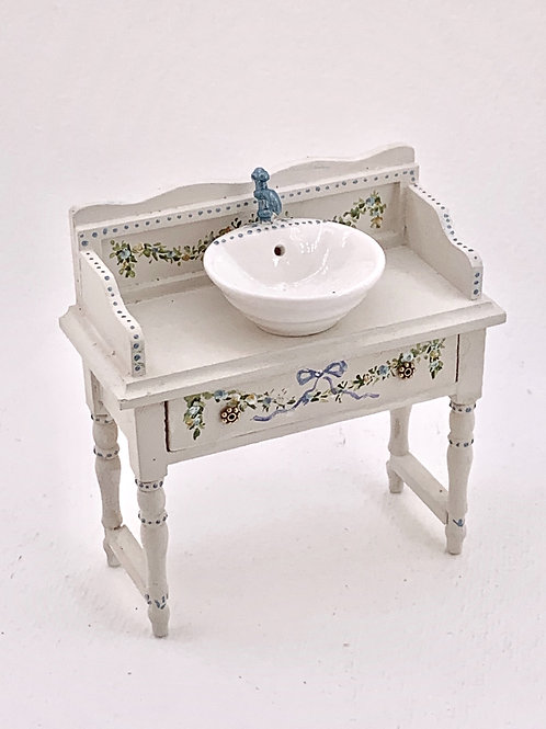 Hand painted furniture with ceramic spike in white and blue tones.