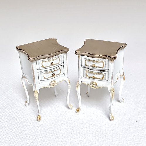 Two white hand painted bedside tables with imitation aged wood. They sold the tw