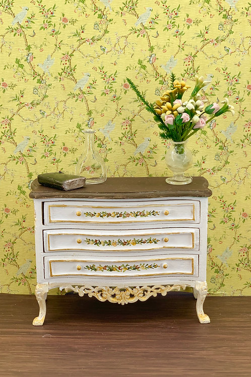 hand-painted chest of drawers with wooden top and flower details in ocher and ye