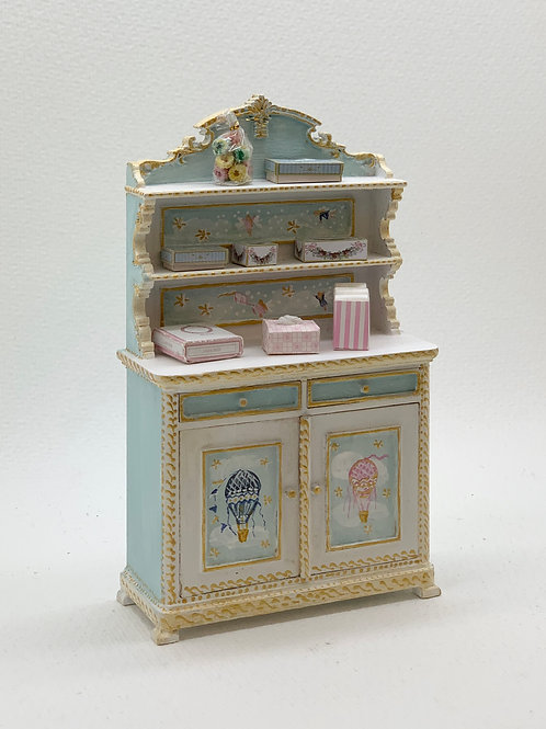 hand-painted cabinet with shelves with children's motifs of air balloons