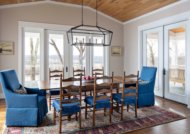 Incomparable views surround this dining room. It doesn't hurt that the space opens to a grill area, outdoor dining, and a covered porch making it the best place to throw a dinner party.
