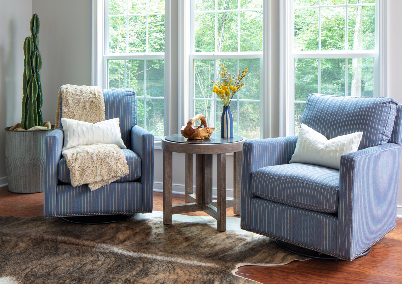 A cozy seating area with swivel gliders allows flexibility in the space.