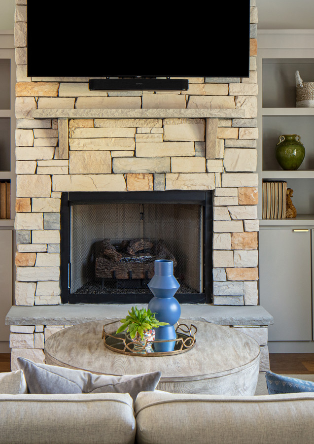 Custom built-in cabinetry highlights the beautiful stonework.