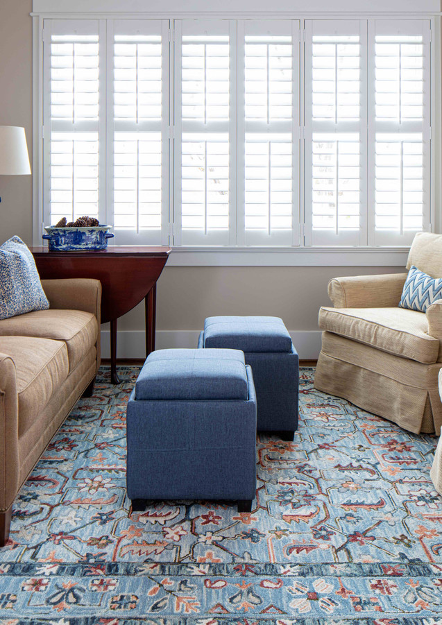 A living area upstairs make the perfect spot to snuggle in with the grandkids when they visit. We used the client's existing furniture and added in a few cheerful pops (like the rug) to bring it all together.