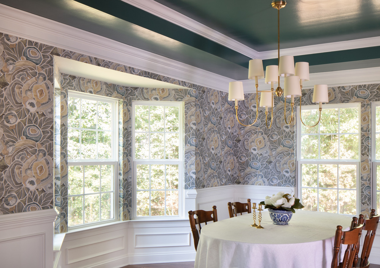 The dining room sits in the darkest corner of the house, so we chose finishes that embrace the moody light, while enlivening the space for dinner parties and Sunday suppers.
