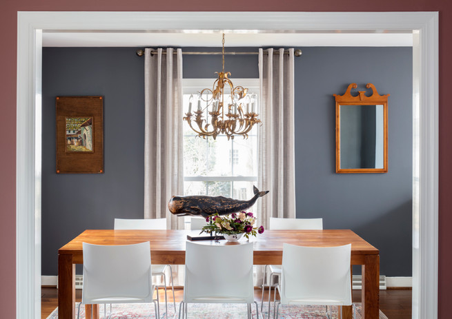 Dining off the living room features commerical grade, wipeable plastic chairs and an unfinished teak table which is quickly oiled a couple times of year to erase all the marks made by its users.