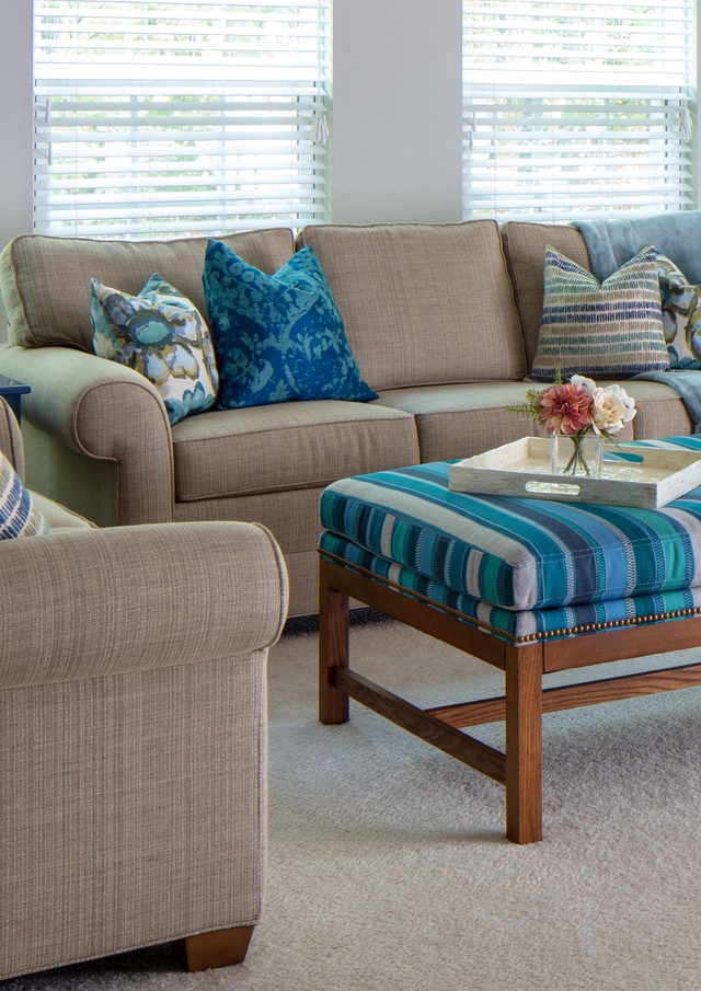 We injected this family room with case goods with personality, custom Carolina blue lampshades, and sumptuous textiles.