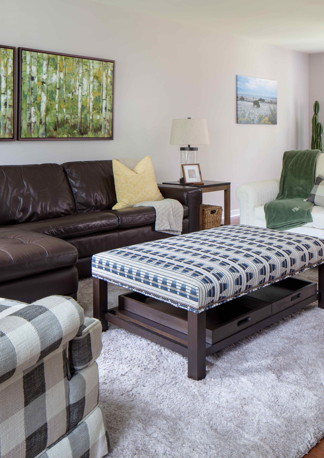 The main living area provides a good amount of seating with the multi-purpose ottoman adding additional seating or drink and beverage placement.